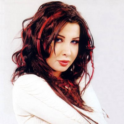 Nancy Ajram is a famous sexy arab singer. Nancy Ajram was only eight when ...